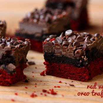 Red Velvet Oreo Truffle Brownie Bars 1 Duncan Hines box Red Velvet cake mix 1/2 cup butter, melted 2 eggs 1 package Jell-O insant white chocolate pudding (3.3 ounces) 6 tablespoons vegetable oil 1 package Oreos 8 ounce package cream cheese 1/2 package (1/2lb) chocolate bark (CandiQuick) (or about 1-1/2 cups chocolate chips) mini chocolate chips for garnish  oven at 325 9x13 nonstick 20 minutes or so...