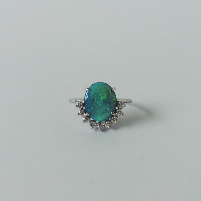 Natalie Marie Jewellery solid black opal set in 18ct white gold with a half moon of diamonds