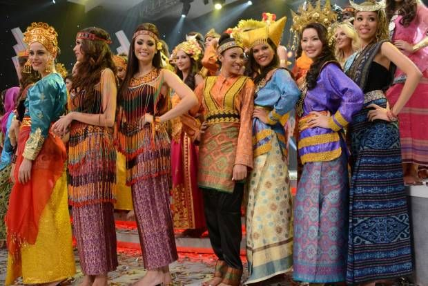 Contestants of Miss World 2013 dress in Indonesian national costumes.