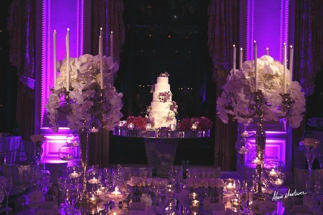 Exquisite #uplight lighting make this wedding cake pop! Great photo via #fabiabrantes #AlainMartinez