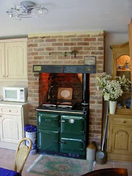 Brick enclosure for AGA Rayburn wood cooker