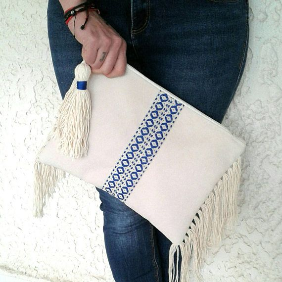 Check out this item in my Etsy shop https://www.etsy.com/listing/523224037/boho-chic-clutch-with-long-fringe-hippie