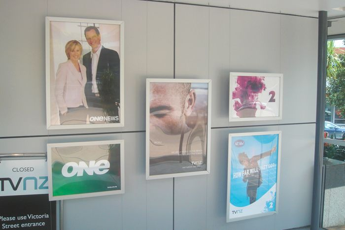 We designed, produced and installed a sophisticated 'suspended snapframe' display. http://www.designation.co.nz/