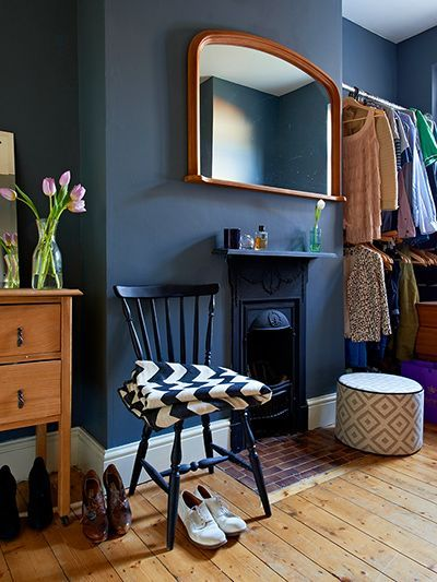 Credit: Ingrid Rasmussen The dressing room – formerly a second bedroom – is painted an inky black (Railings by Farrow & Ball is similar). The monochrome Chevy throw is Murphy's own design.: