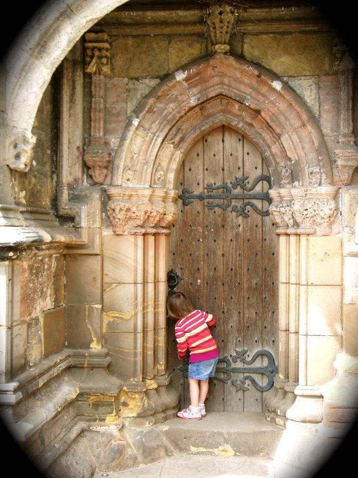 Peeking into Rosslyn Chapel, Scotland ~ Photo by Alan Hockstein.