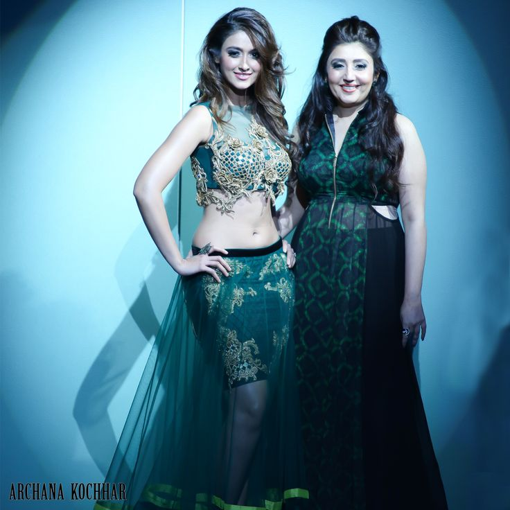 Ileana D'Cruz is looking beautiful and playful in Archana Kochhar - An ace couturier latest bridal range, the malachite green and gold embroidery looks rich and somptous, the silhouette is interestingly crafted light sheer lehenga with a short skirt to give it a young and playful look.