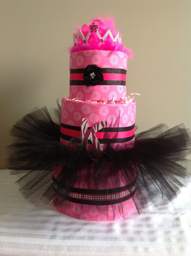 Custom diaper cake for a pink/black & tiaras/tutus Baby Shower. Contact us to have one customized to match your shower decor. Facebook.com/perfectlittleadditions OR email us at perfectlittleadditions@ yahoo.ca.