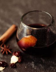 Glogg, a Swedish mulled wine, is traditionally served with almonds and raisins. Feel free to substitute your favorite dried fruit and nuts.
