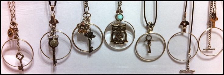 Monocle pendants created with recycled vintage optical lenses, beads, and charms.