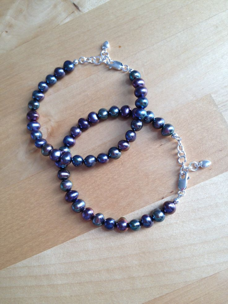 Black Freshwater Pearl Bracelet (MGB44) $35.00  Beautfiul black freshwater pearls are strung onto strong and flexible beading wire with a sterling silver lobster clasp closure. Includes a 1 inch extender for the perfect fit.