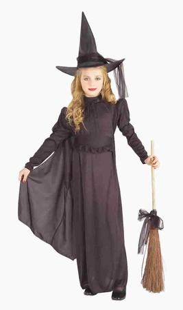 Your little girl will look like the perfect classic and ghoulish witch with our Classic Witch costume! For any bewitching Halloween or costume party, our Classic Witch features an all black costume with a witch's hat wrapped using a taffeta scarf, a dress with an attached cape, and a belt. Additional witch-related costume accessories are available and sold separately.