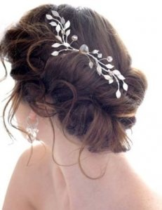 Curly Updo with Floral Accessory is Perfect for Wedding Day