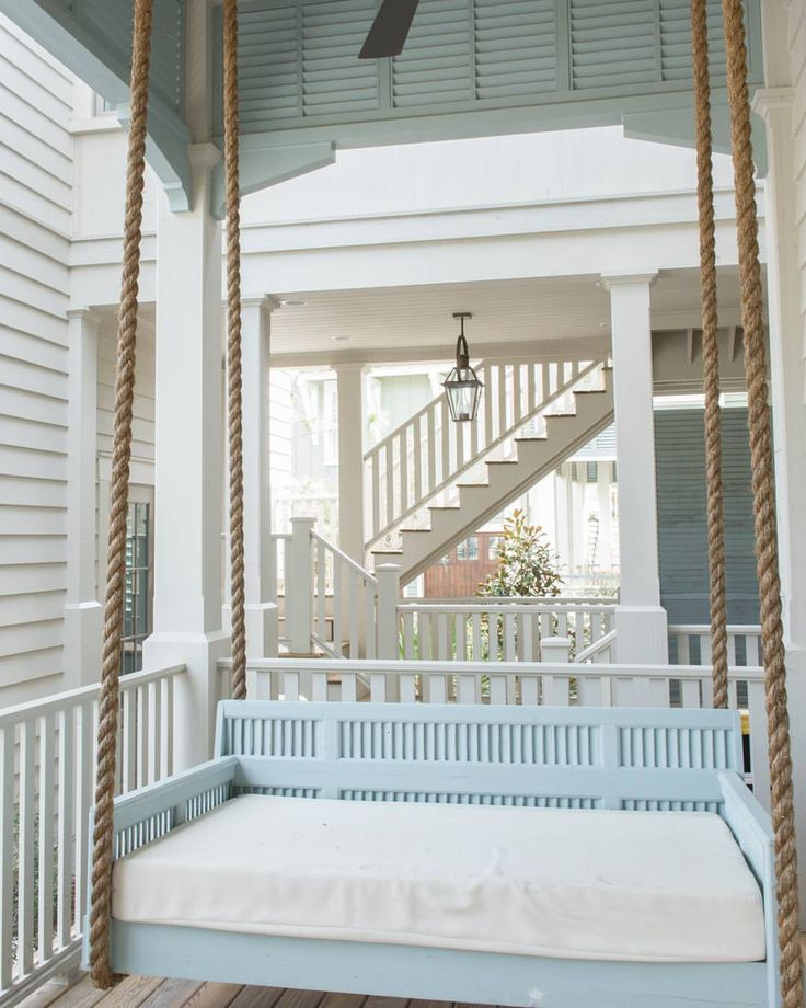 Forget it's only #Tuesday... we all can pretend we're on a #SummerVacation with this #Florida #BeachHouse designed by one of my favorites #architects, @tsadamsstudio. #Interiors by Courtney Dickey. #Porch #Swing paint color is #@Lhomebunch.com  #homeideas #interiodesign #beautifulInteriors #beautifulhomes #coastal #Coastalhomes #beach #porchswing #rope #blue