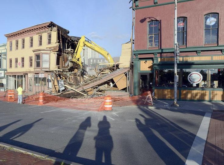 Late afternoon sun cast long shadows as demolition of four thru ten King Street adjacent to Bombers takes place Monday, August 5, 2013 in Troy. (J.S. Carras / The Record)