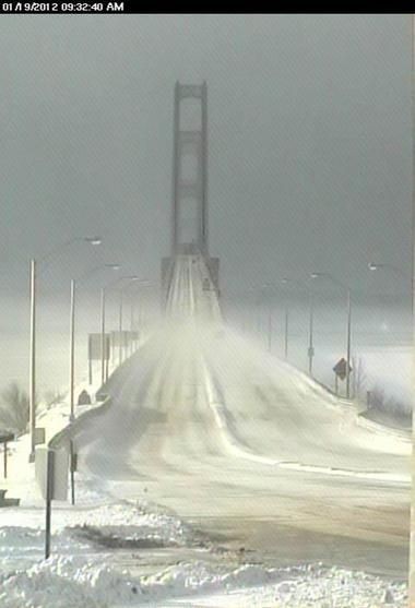 Winter descended in full force on the Mackinac Bridge on Thursday 1/19/2012 at 9:32 am, and the eerie starkness was captured by the Mackinac Bridge Authority's webcam.