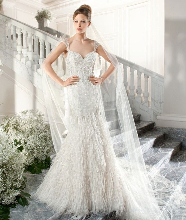 Feather textured wedding dress | Demetrios Couture 2015 Bridal Collection via @WorldofBridal