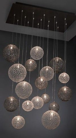 Modern chandelier...cool idea for a basement bar!