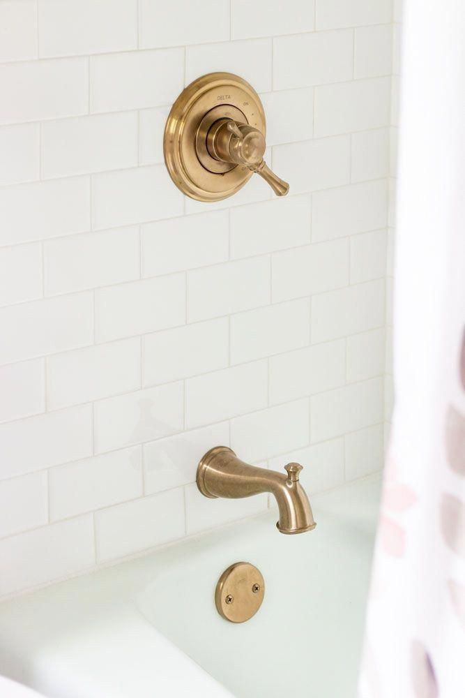 White Subway Tile Shower Surround And Champagne Bronze Fixtures