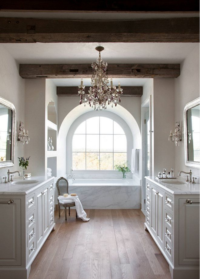 This bathroom exudes warmth, luxury, and sophistication.