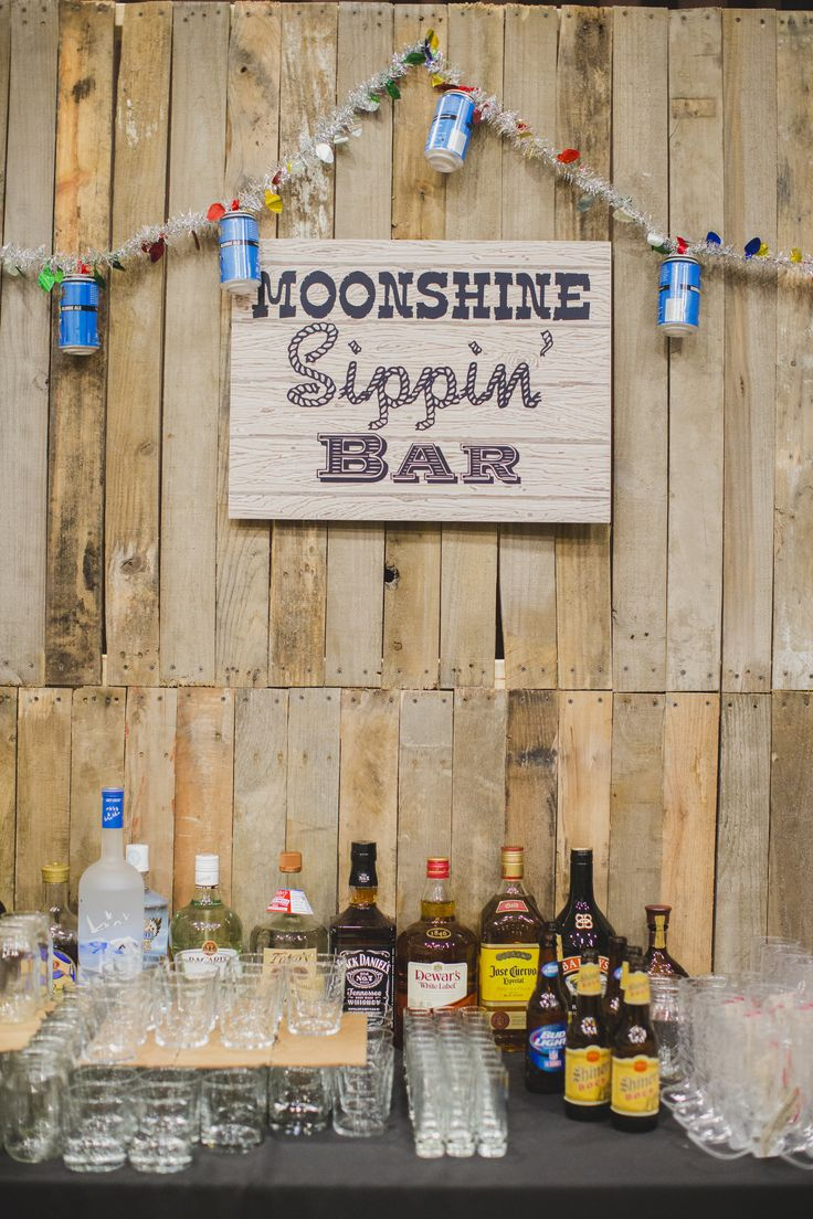 www.occasioproductions.com  Honky Tonk Christmas Bar Moonshine Sippin Bar, Crate and Hay Bar Beer Can Garland  Photo by: http://michelleablephotography.com/