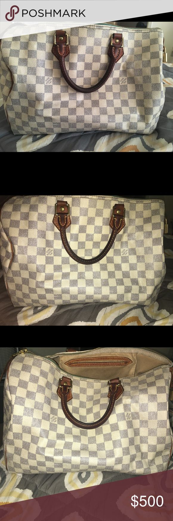 AUTHENTIC LOUIS VUITTON SPEEDY 35 DAMIER AZUR Hi!! I have had this bag for over 6 yrs or so. STILL IN GREAT CONDITION!! It's literally normal wear and tear. The inside is clean.. and it has its original lock and key with it as well... slightly discolored again from normal wear and tear (and age) but still has ALOT of life in this bag! Louis Vuitton Bags Satchels