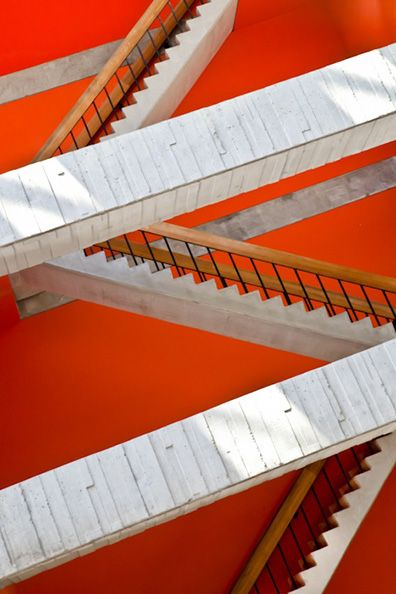 Wilson Hall, Chicago (photo: Yorgos Efthymiadis).: Wilson Hall, Home Design, Design Blogs, Orange Wall, Criss Cross, New England Homes, Chicago Architecture, Wooden Stairs, White Stairs