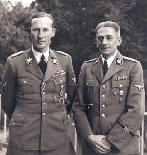 Reinhard Heydrich, Reich Protector of Bohemia and Moravia, with Gruppenführer (later Obergruppenführer) Karl Hermann Frank, Higher SS and Police Leader and Minister of State, photographed in Prague, early 1942.