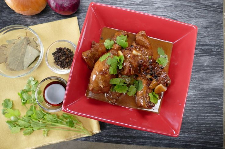 Recipe with video instructions: In some regions of the Philippines people put coconut milk in their Adobo, a stew staple in the country. Ingredients: 1 whole chicken leg, 4 boneless chicken thighs , 1 tbsp of olive oil, 4 sliced pieces of garlic, 1 small red onion, sliced, ¼ cup of distilled vinegar, 4 tbsp of soy sauce, 1/3 cup of water, 1 tsp of black pepper corns, ½ cup of coconut milk, 1 laurel leaf, Coriander to garnish