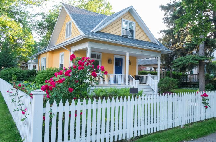 This adorable house is very inviting. We love the bright colors and gorgeous white picket fence! See 75 Fence Designs and Ideas at http://www.homestratosphere.com/fence-designs/#utm_sguid=163048,8bbb3f56-e165-88d2-743e-0c4816eb1e5b Find 100s more landscaping ideas at