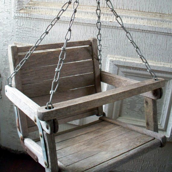The bar in front slid up to get in the swing. (baby swings of our days!)