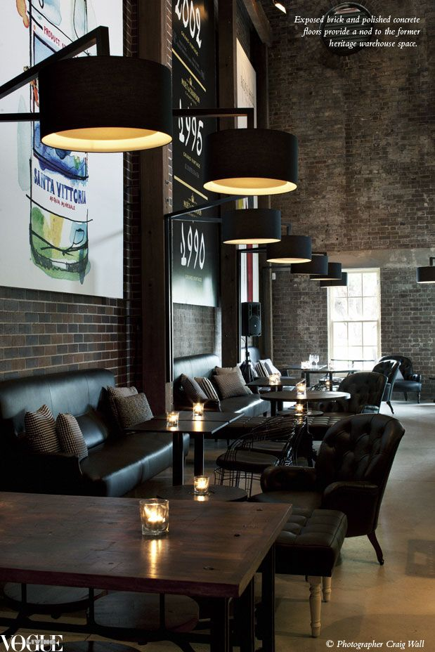 The raw exposed bricks against the inviting leather lounges works really well. I also think the large printed graphics and pendant lights give the space character!