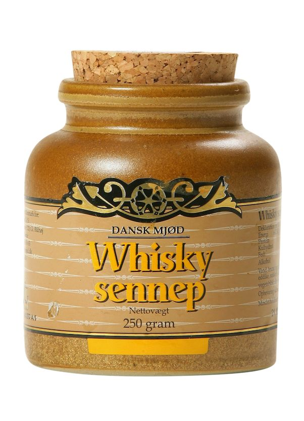 A fine and sweet mustard with whisky, which is good as a spice and as a base for dressings for many dishes.  Contents : Water, brown and yellow mustard seeds , vinegar , sugar, salt , whisky (1.6%) , vegetable oil and spices.  Medium strong mustard in 250 gr. Ceramic pot .