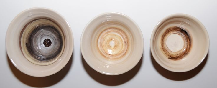three brown whirling bowls, painted with red iron oxide, rutile and tin oxide.