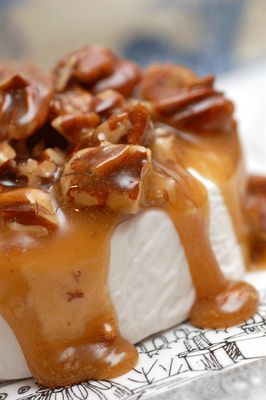 Pecan Caramelized Brie. It's said to be easy & incredible.