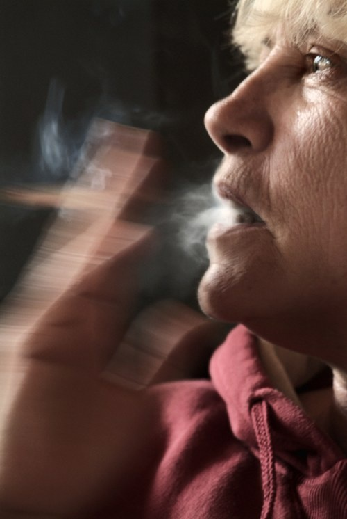 Smoking ages skin - close up of female smoker's face shows the damage