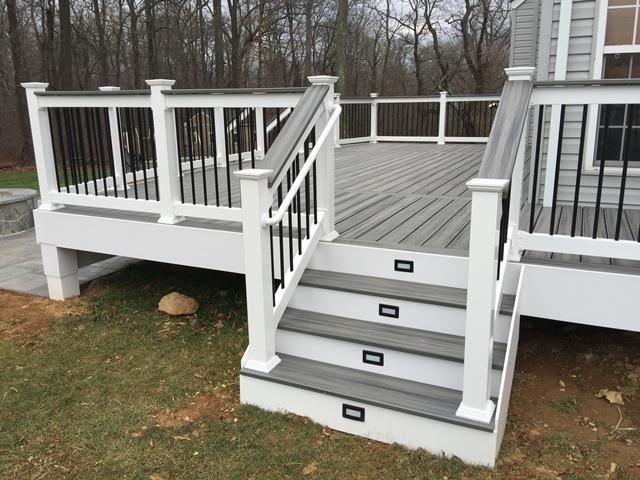 trex deck steps lights cap rail white vinyl railings vinyl trim wrap black metal balusters paver patio fire pit