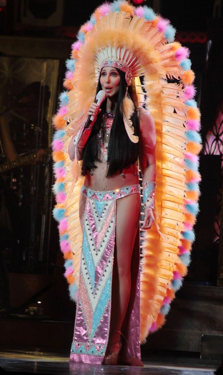 Rainbow feathers and tribal prints had their time on stage as the singer crooned to excited fans in Boston.