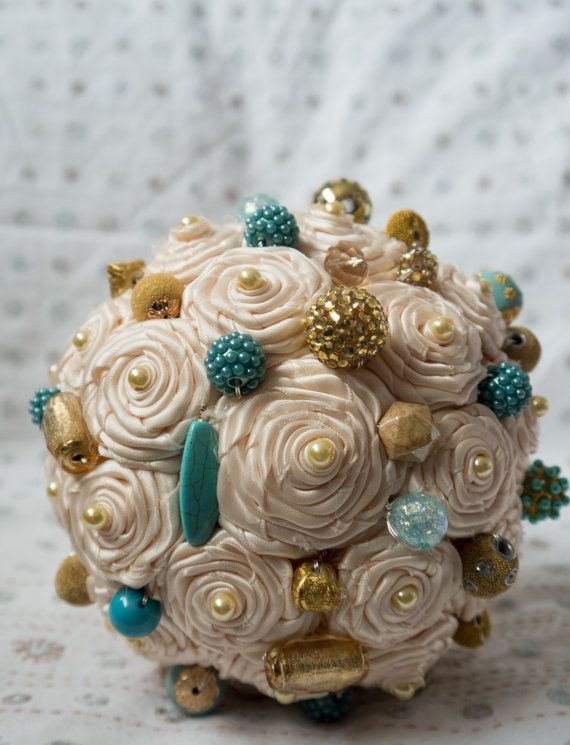 This unique lollipop style bouquet is 100% handmade. All roses are handmade and finished with a variety of turquoise and gold shaded beads.