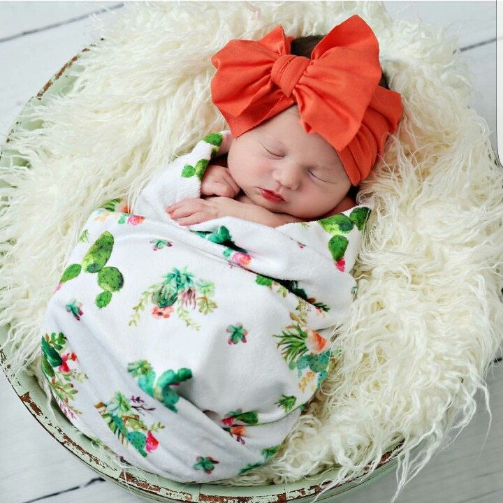 This darling girl looks lovely in her cactus swaddle