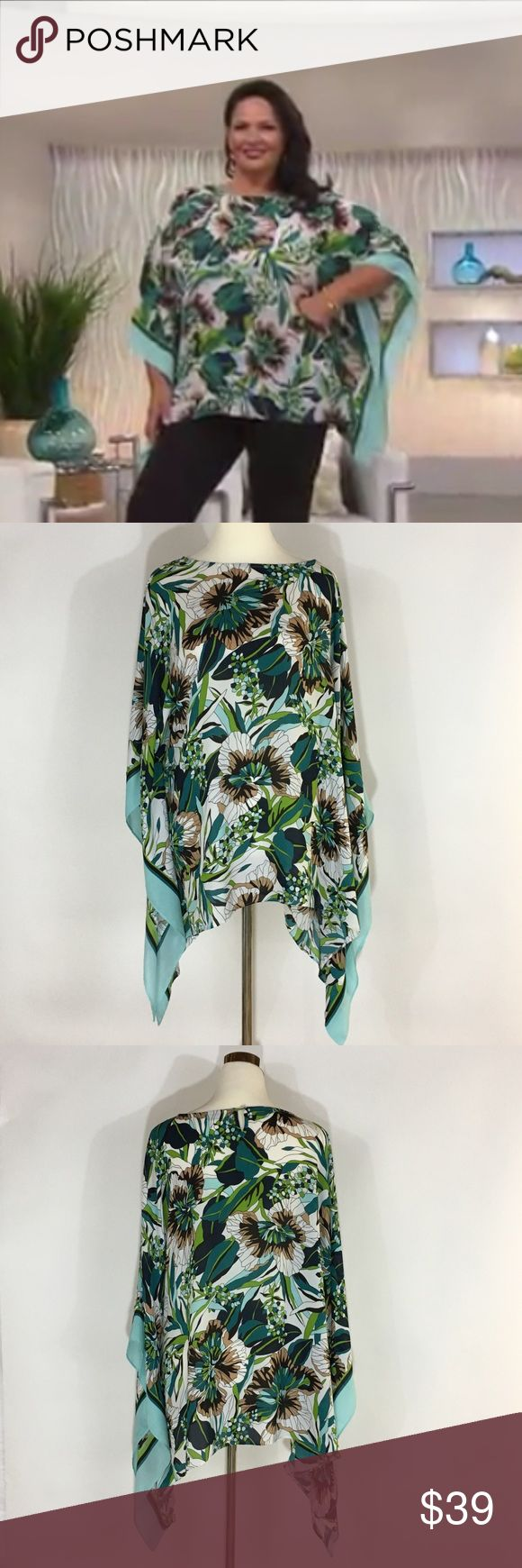 """Joan Rivers Tropical Floral Print Caftan Top Put this on, and you'll never want to take it off. Where else can you get so much drama in one piece? This top features open batwing sleeves, side slits, and a captivating print. From the Joan Rivers Classics Collection * Teal Floral print with striped border, open batwing sleeves, side stitching, side slits * 1X(18W-20W) * Relaxed fit; Approx length measurements 29"""" * 100% polyester * Machine wash, line dry * Made in China  Pristine Condition…"""