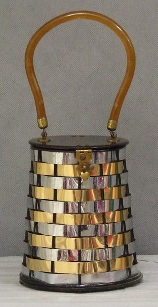 Silver and gold metal basket-weave lantern-shaped handbag with a dark tortoise-colored Lucite lid, by Dorset Rex Fifth Avenue, c. 1950's.