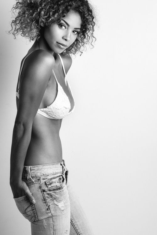 Model Christina Zangas black and white editorial portrait in jeans and swimsuit by Jeff Walton Photography