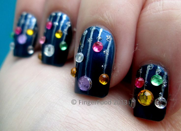 Christmas bauble manicure - midnight blue/black base, silver stripes and glitter, and multi-coloured rhinstones for baubles. | This mani is so cute and novel - fun for the holidays, or other special occasion!