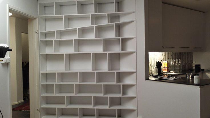 Book shelving unit design integrates in this area.