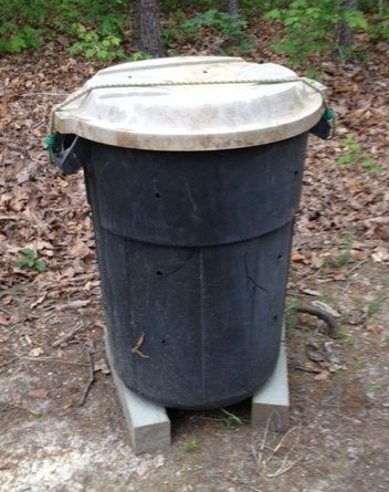 Compost bin out of garbage can.
