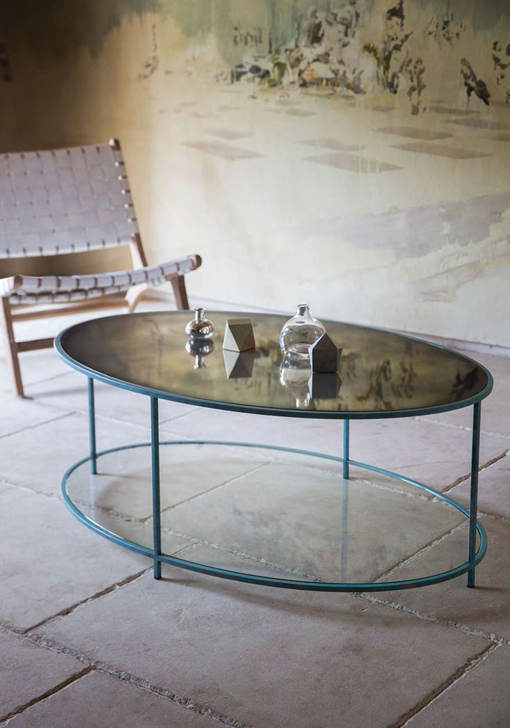 Lexington oval #coffee_table.  120 x 70 x H42cm.  Finished in #Verdigris with hand #antiqued_mirror and clear #glass bottom shelf.