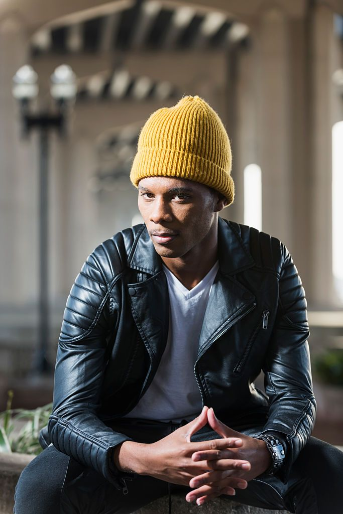 A serious, young African American man wearing a yellow beanie hat and... | Yellow beanie, African american men, How to wear