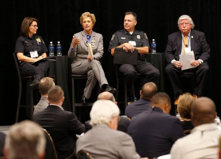 Lexington Fire Chief Kristin Chilton, left, Fayette County Sheriff Kathy Witt, Lexington Police Chief Mark Barnard and moderator Alan Stein took questions and discussed public safety issues during a Commerce Lexington's Good Morning Bluegrass event at the Hyatt Regency in Lexington Friday.