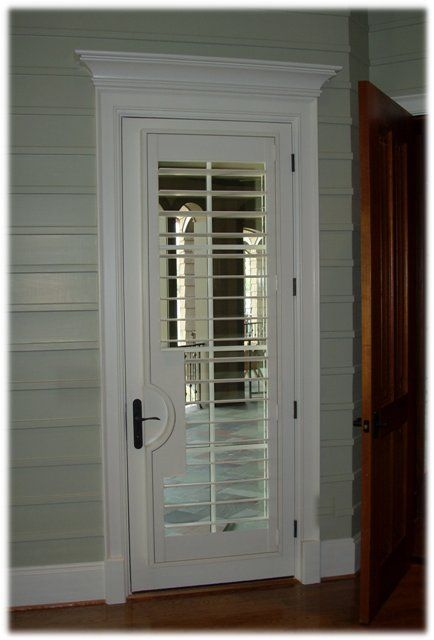 Plantation Shutter On French Door With Lever Cut Out And