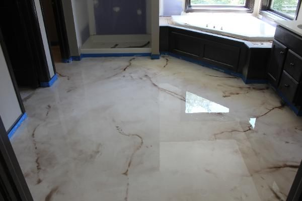 SBR Concrete Bedford Hts, Ohio  Reflector Enhancer metallic epoxy floor made to look like marble for a master bathroom floor.
